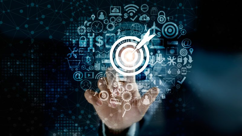 Digital marketing. Businessman touching darts aiming at the target center with icon network connection. Business goal and technology concept